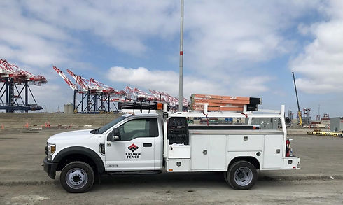 truck with crown fence logo at construction site