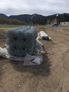 bundle of chain link fencing stacked together