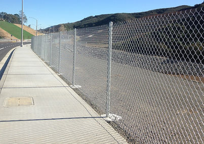 side view of chain link fence on side walk