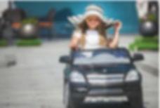 Child driving toy car.JPG