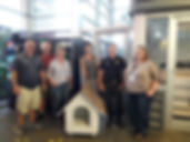 Picture at ACPS with dog house.jpg