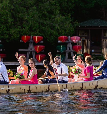 Wedding party arriving to the ceremony in the war canoe