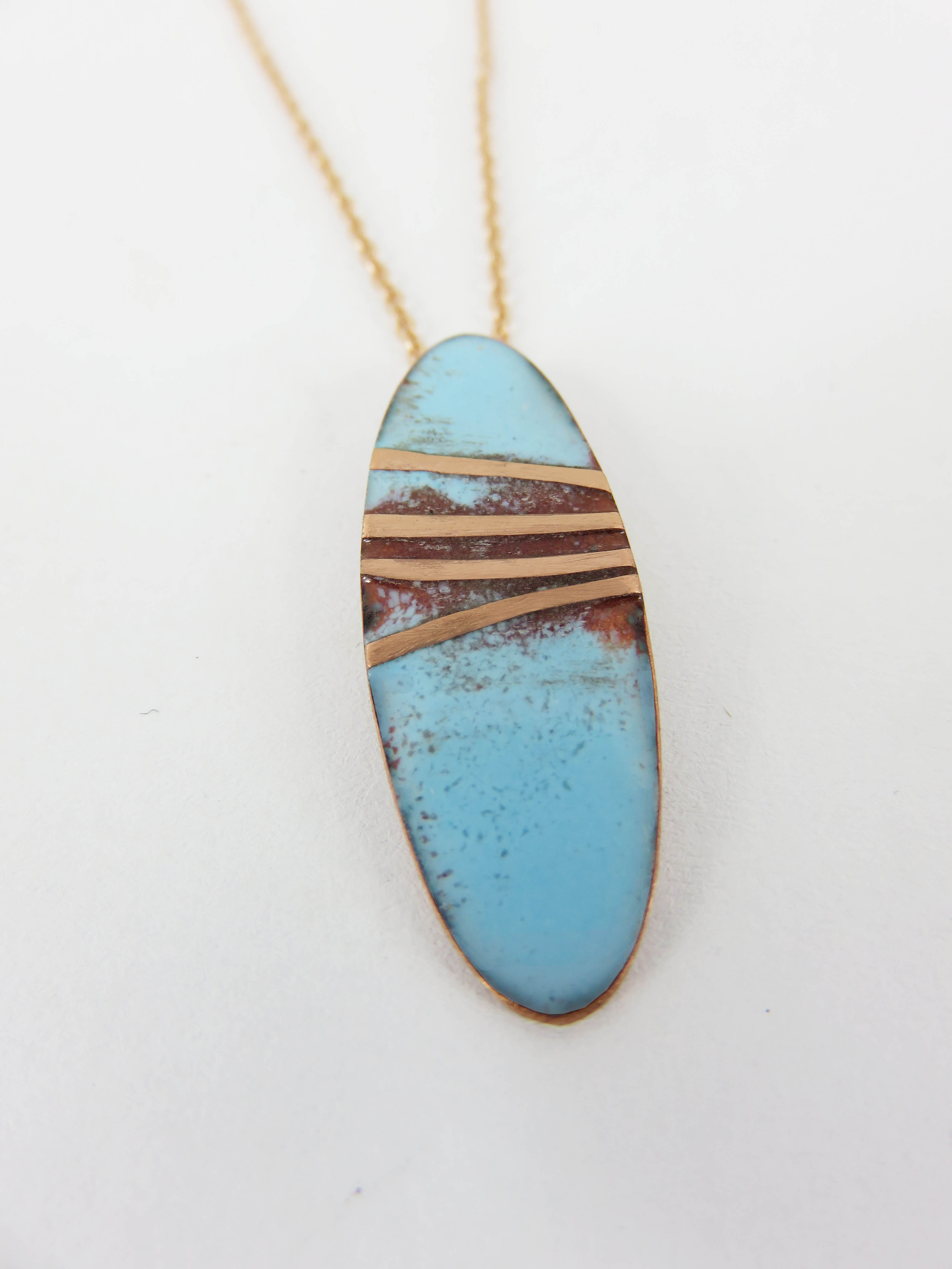 oval with copper straps