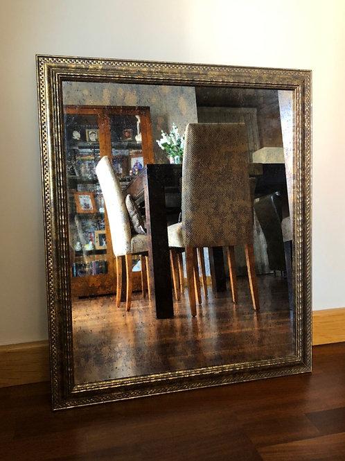 Espejo ornamental con cristal ahumado