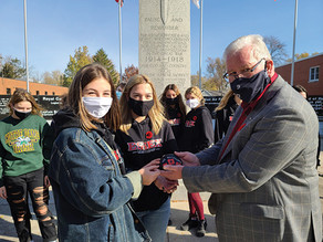EDHS Leadership students paint, then place Remembrance Day rocks at cenotaph