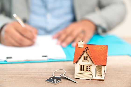 real-estate-concept---businessman-signs-