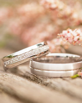 Silver wedding rings on a wooden  backgr