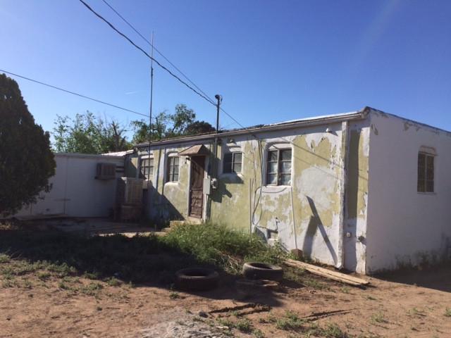 I bought an ugly house Albuquerque