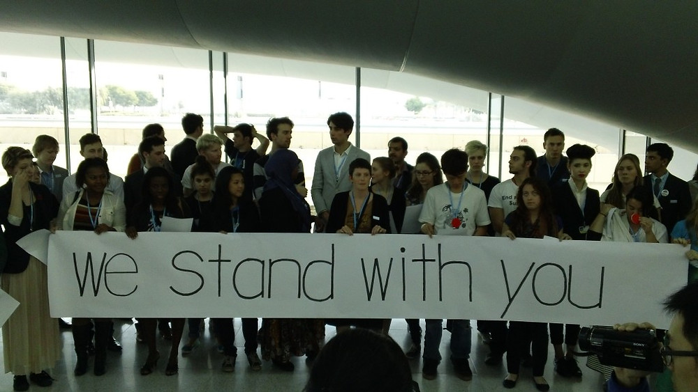 Youth voicing support for developing countries who were taking a strong stance against developed countries during UN climate talks in Doha