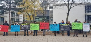 Reclaim Power's eight demands outside the entrance to COP 23