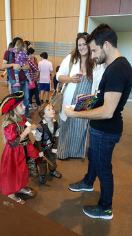 Little Pirates meeting one of the actors from Story Pirates