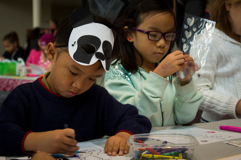 Kids enjoying arts & crafts before a show