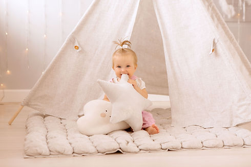 baby girl playing in the nursery, baby learning to walk, textiles for the nursery, tent in