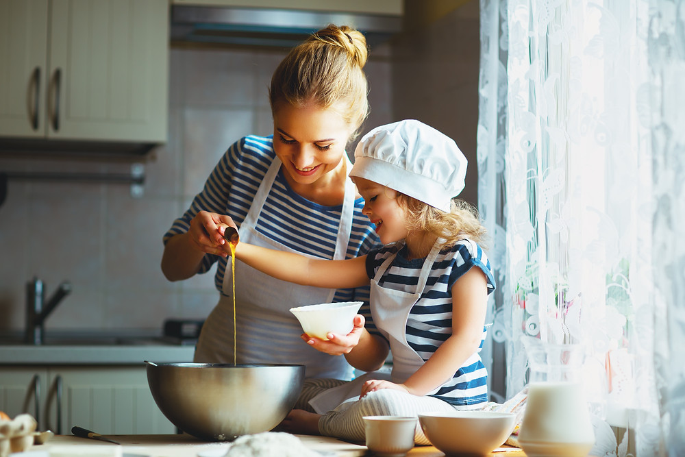 Mother and daughter baking in the kitchen,