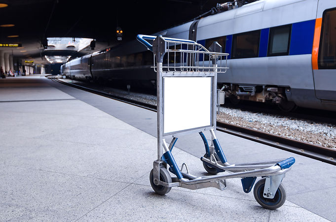 Empty luggage cart on the metro station.