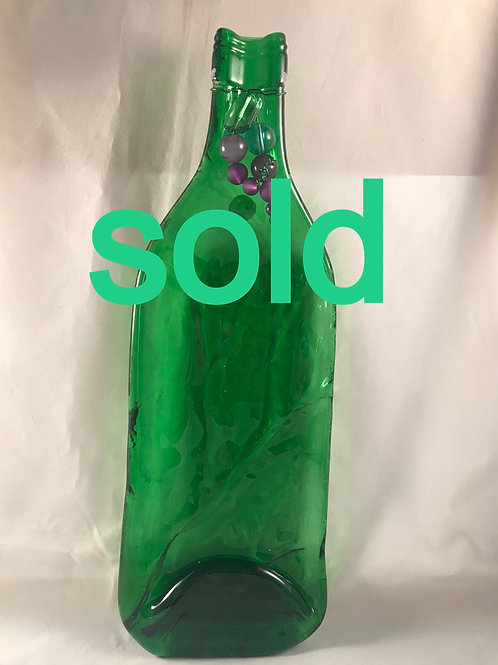 CP12  LIGHT GREEN SLUMPED BOTTLE WITH PURPLE BEAD SPOON REST