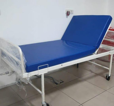Simple hospital bed with mattress folded