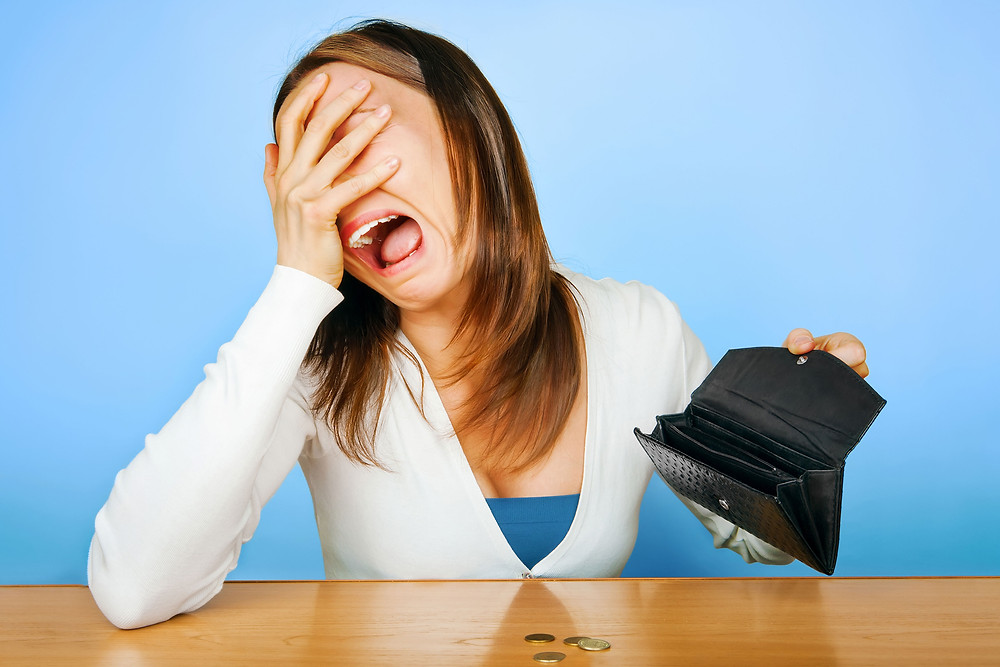 Girl crying with empty wallet