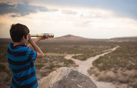 kid with telescope