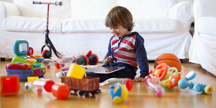 kid with toys and gadgets