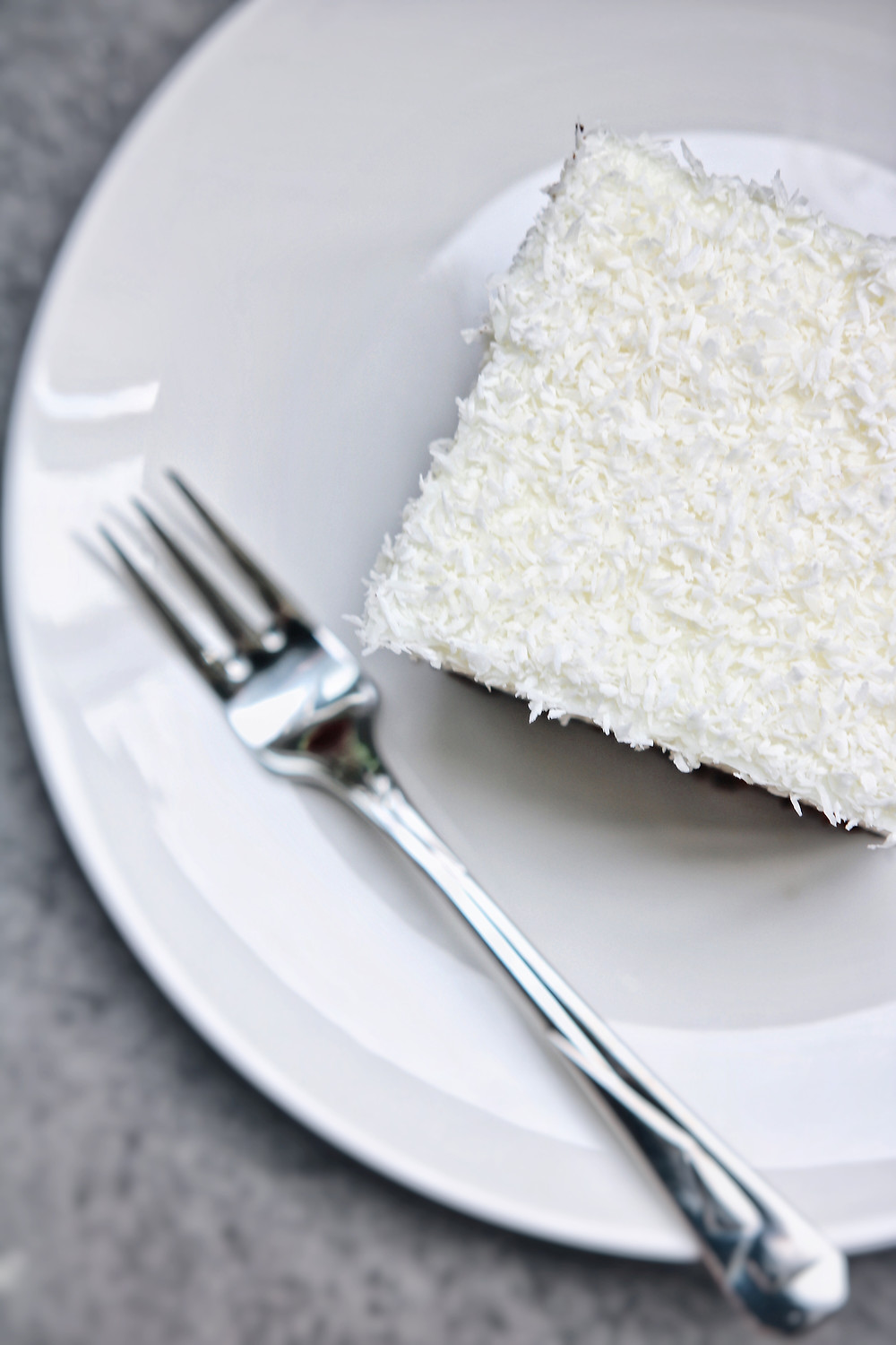 A coconut pudding bar served on a white plate.
