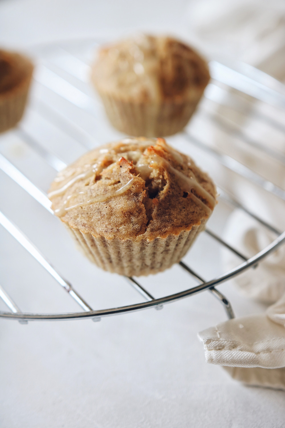 A side view of gluten free banana muffins, others in the background.