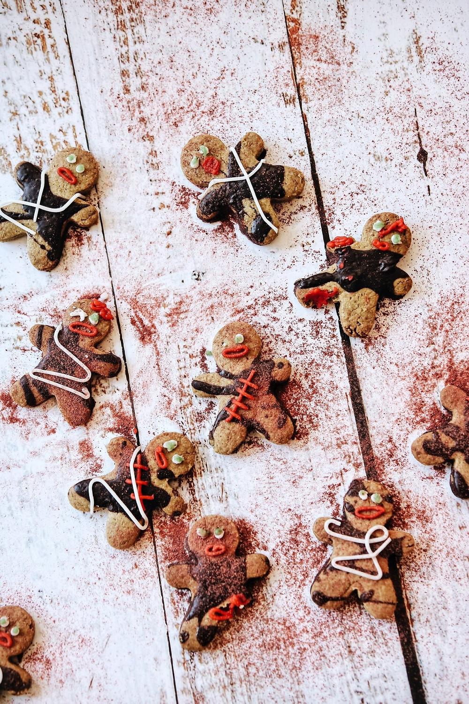 Half a dozen zombie cookies on a white background.