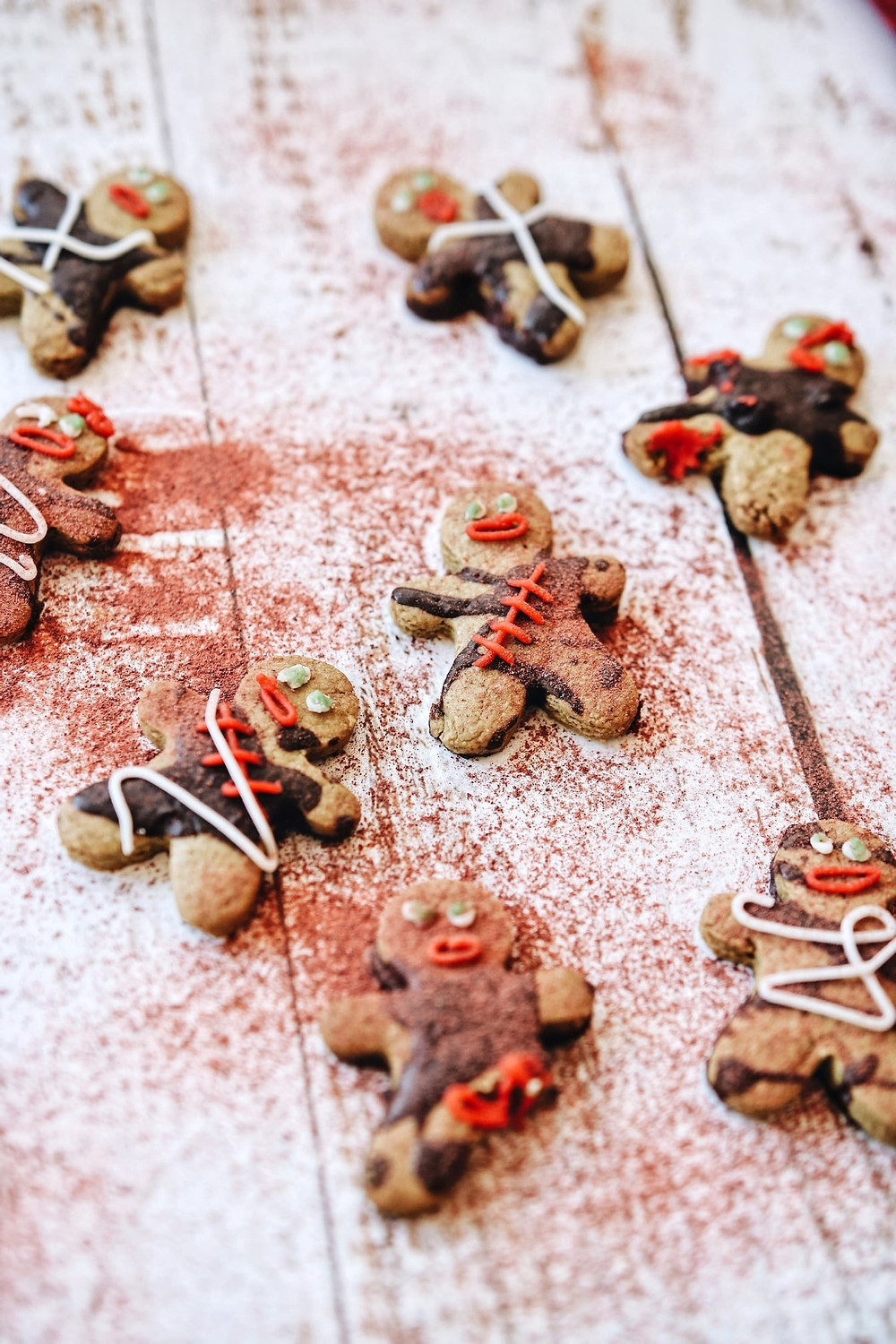 Spooky gluten free Halloween Zombie cookies on a white and red background.