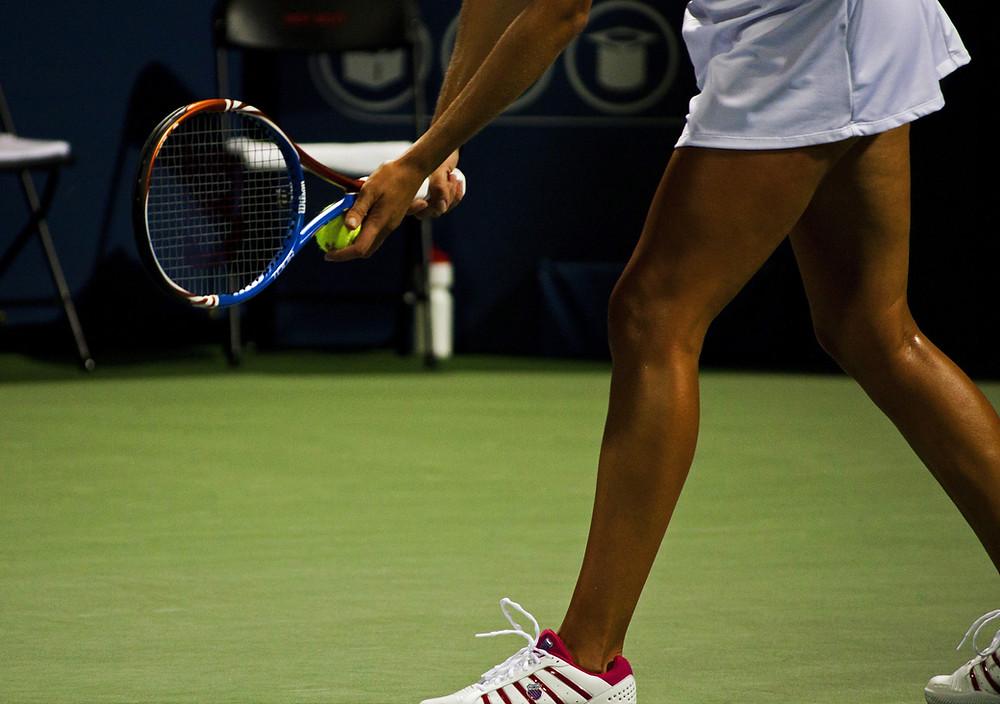 Tennis Player preparing a serve.