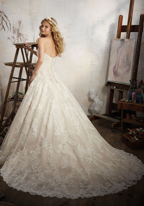 Len Con Lace AppliquZes Accent This Classic Bridal Gown Featuring A Strapless Sweetheart Neckline And Tulle Ball Skirt With Wide Scalloped Hemline