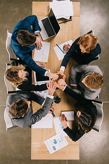 overhead-view-of-business-partners-at-ta