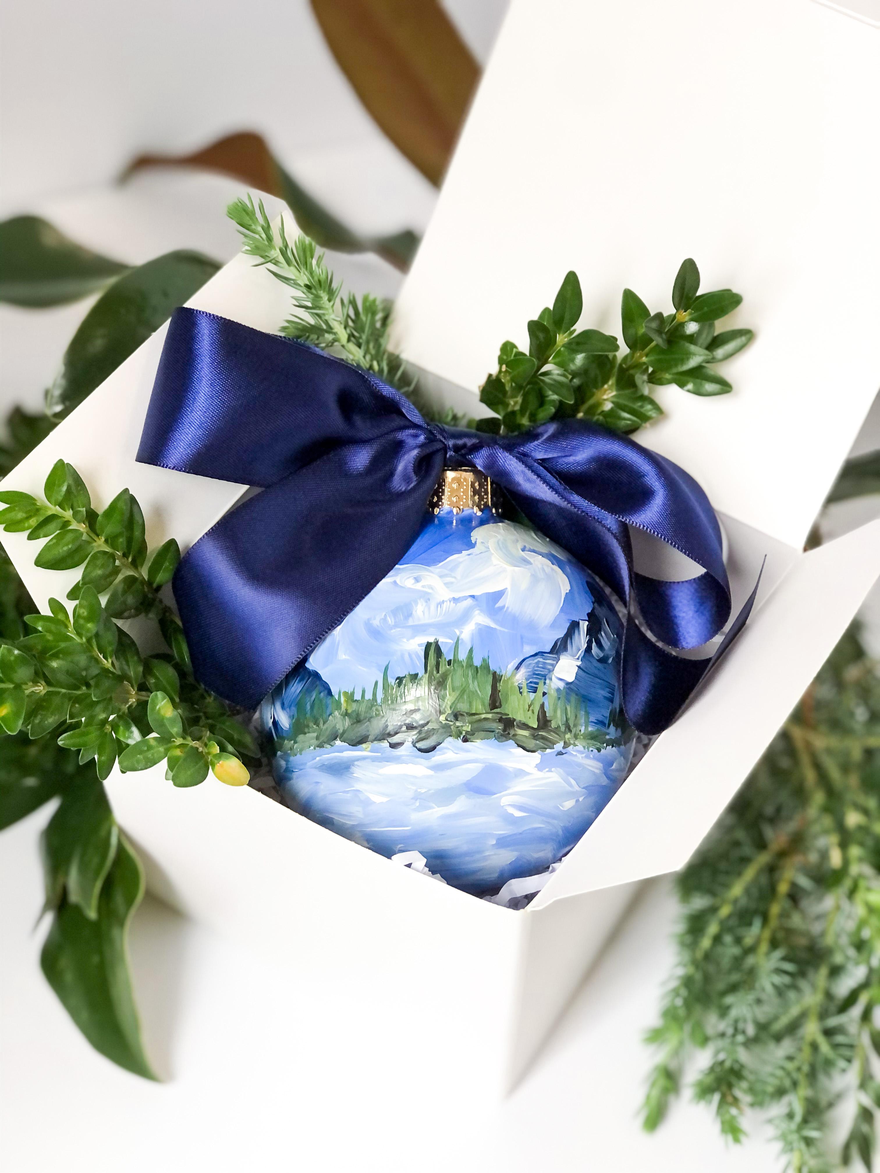 bright blue ribbon ornament in box
