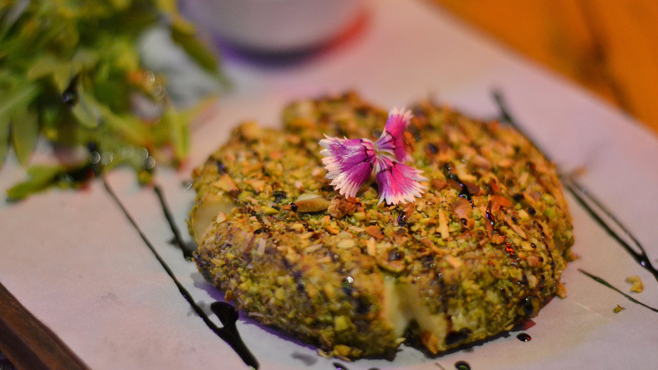 PISTACHIO CRUSTED BAKED BREE WITH WALNUT RELISH