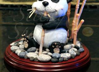 Hand sculpted panda topper