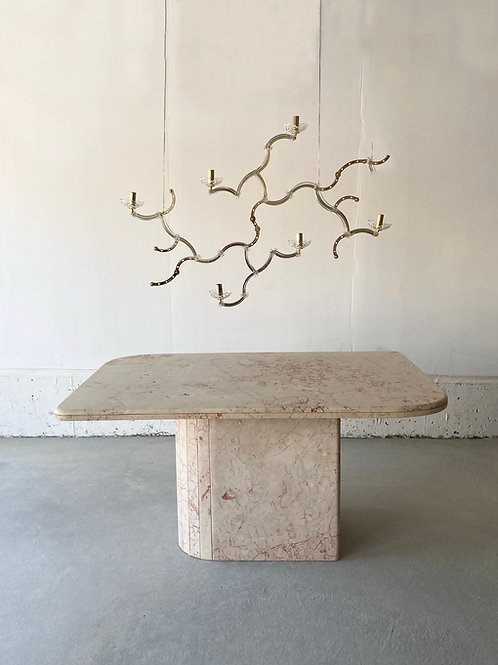 Pink marble dining table with asymmetric corners