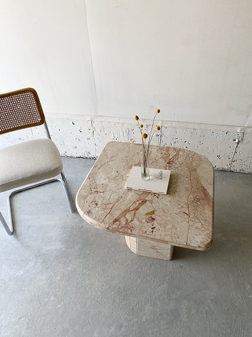 Pink marble side table with asymmetric corners