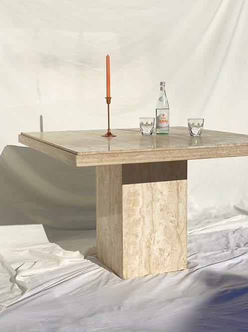 Square travertine dining table