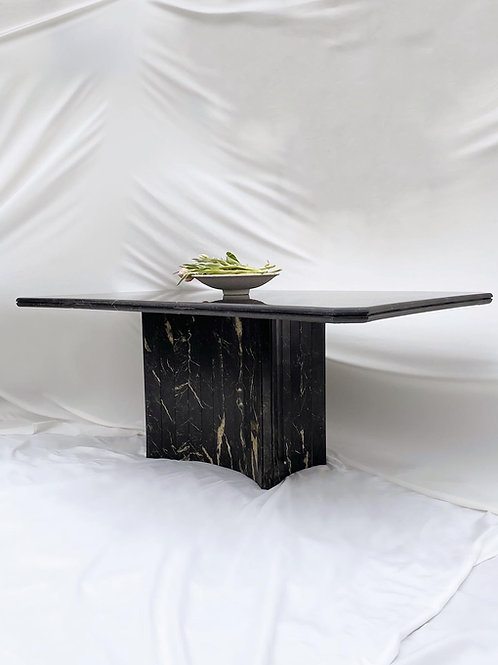 Concave shaped black marble dining table