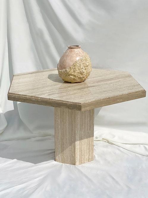 Hexagonal travertine dining table
