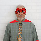 Dr. Albert Klein in a red cape and mask