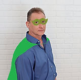Dr Norm in a green cape and mask