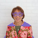 Dr Bobbie in a purple cape and mask