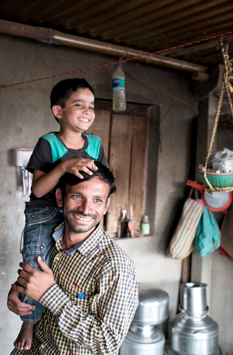 Indian father playing with his son.