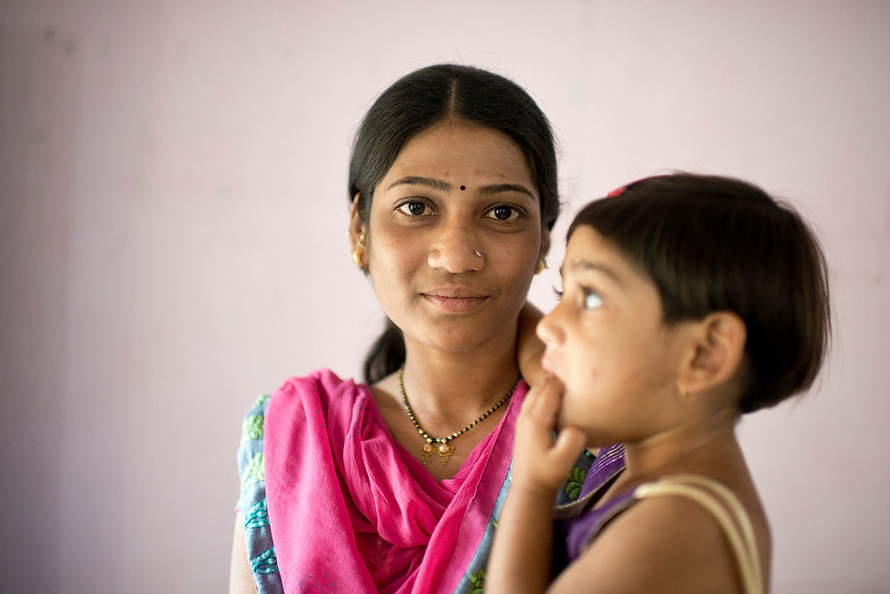 Women survivors of domestic violence are seen at a shelter home in center India.