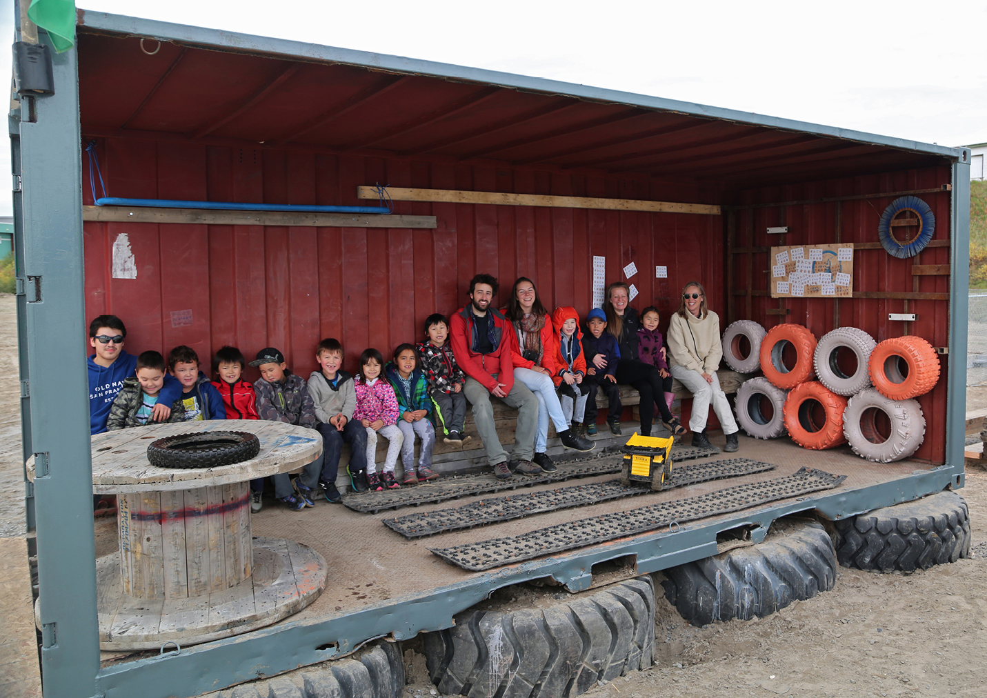 Group photo with students in the shelter