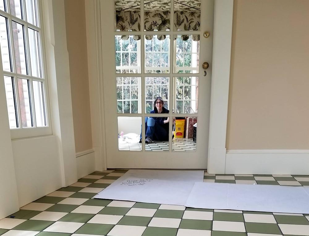 Laura Linett faux finishing a wood floor to look like tile