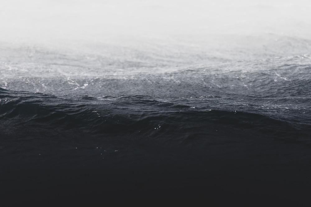 rain on a dark ocean