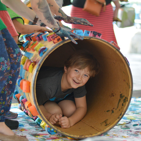 Child Playing in a Tube