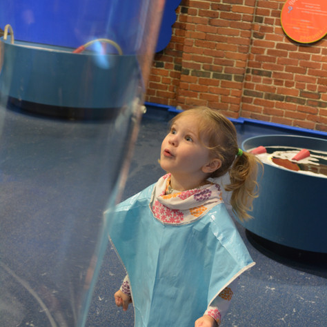 Child Fascinated By Bubble