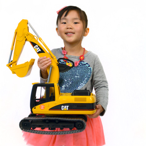Girl Holding a Toy Truck
